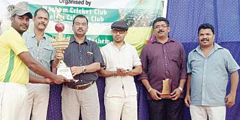 Well deserved:?MCC skipper poses with the trophy along with  GCA Secretary Chetan Desai, Nilesh Prabhudesai, Prashant Pai Kakode and Daya Pagi, at Canacona, recently.