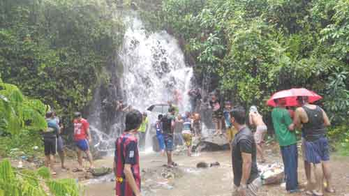 Youth enjoying a bath at the Azossim waterfall, as Goa witnessing incessant rains for the last couple of days.
