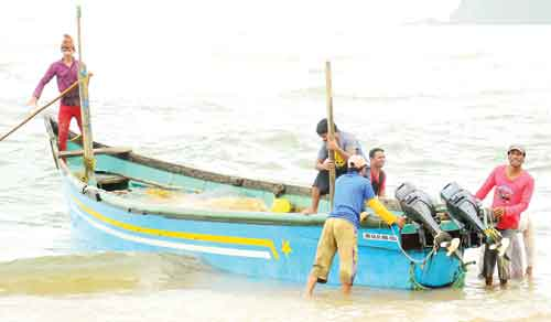 Fishermen use a mechanised canoe to carry out fishing during the ban period.