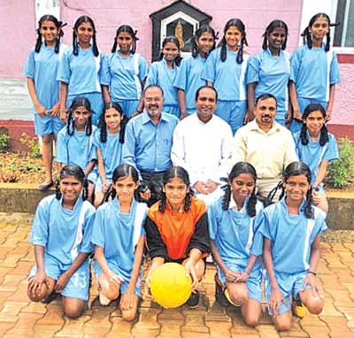Shining stars: Our Lady of Fatima High School teams, which emerged champions in the under-14 and 17 girls table-tennis Sanguem taluka championships,  along with Headmaster Fr Jerry Vaz, PE Teacher Felix and senior teacher Sanjay Dessai, at Sanguem.