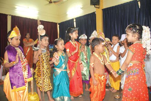 Students from Mushtifund Marathi Medium School participate in Janamashatami programme.