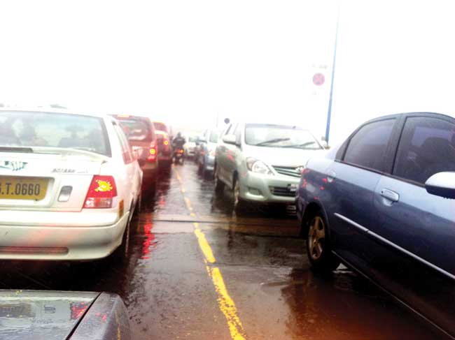 Chock-O-Block: Vehicles left stranded after a KTC bus broke down on the Zuari bridge on Thursday evening.