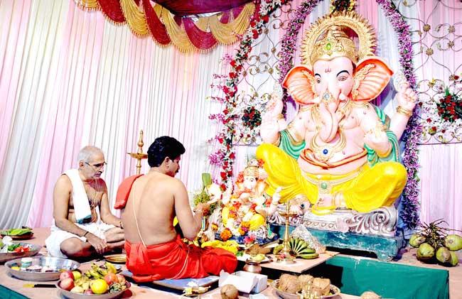 A Hindu priest performs puja to install the Panajikar Sarvajanik Ganesh at Panjim on Friday.   Photo by: Vincent Braganza