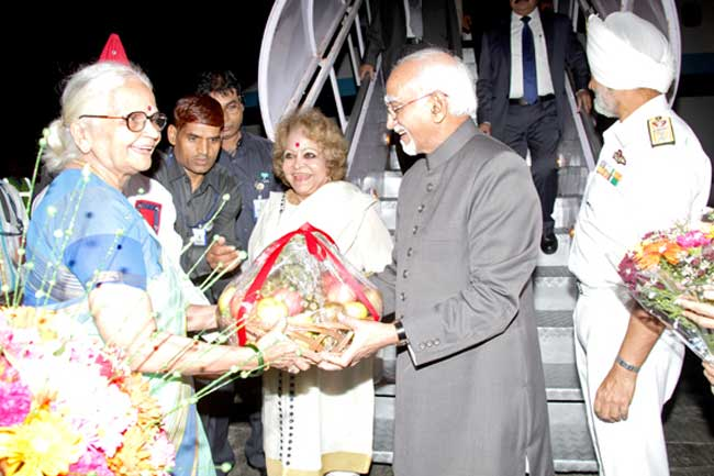 Goa sojourn: Vice President Hamid Ansari along with his wife, Salma, being welcomed to Goa on on Sunday evening. The vice president will proceed to Karwar on Monday for a visit to naval aircraft carrier INS Vikramaditya. This would be his first visit and