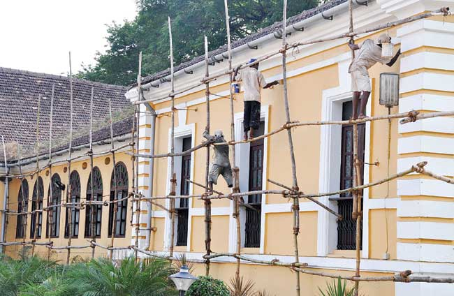 Bring on the shine: Painters give a fresh coat of paint to the Maquinez Palace ahead of  IFFI in Panjim on Thursday.   Photo by: VINCENT BRAGANZA