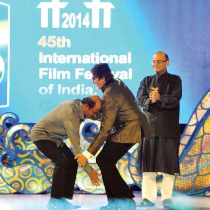 When superstars meet: Tollywood superstar Rajinikanth pays respect to Bollywood superstar Amitabh Bachchan at the inauguration of the 45th Iffi at Taleigao.   Photo by: Vincent Braganza