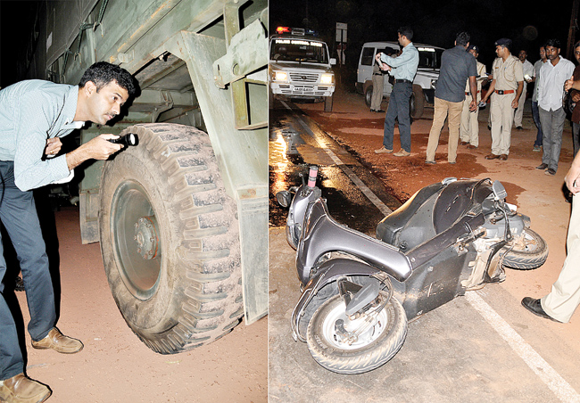 Old Goa Police Station inspector checks the truck belonging to 2STC after it ran over an Activa scooter rider killing him on the spot on the Panjim-Bambolim NH 17 on Wednesday.   Photo by: VINCENT  BRAGANZA
