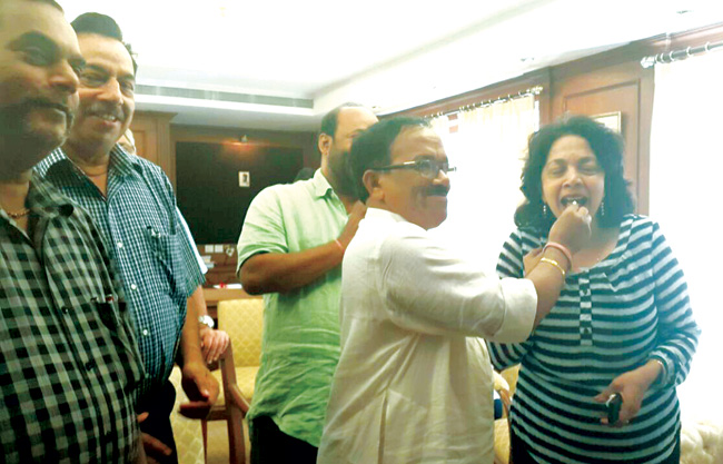 Bitter sweet: Chief Minister Laxmikant Parsekar offering a piece of the birthday cake to Environment Minister Alina Saldanha in the presence of Deputy CM Francis D'Souza and Panchayat Minister Dayanand Mandrekar on Friday.