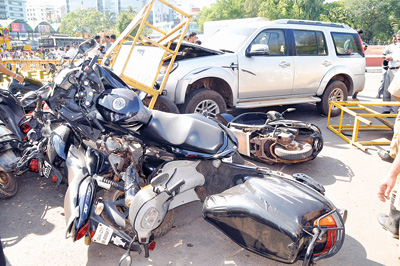A car seriously injured a rider before banging into sixteen parked two wheelers near  Kranti Maidan in Panjim on Tuesday.