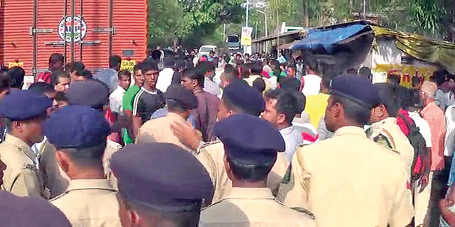 Damage control: Police officials try to pacify the irate crowd at the accident site.  Photo by: santosh mirajkar