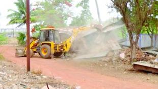 Structures on 'Navy land' demolished