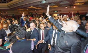 Demonstrations greet Modi in UK, turn aggressive as Indian tricolour ripped