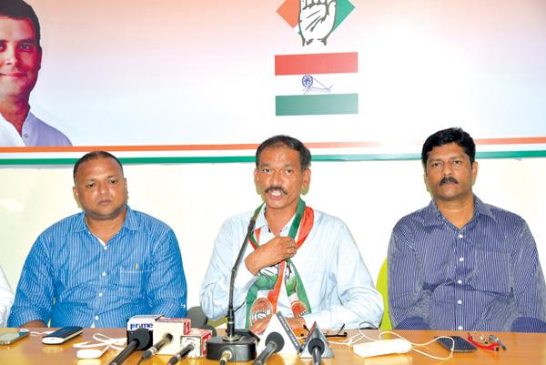 Girish Chodankar speaking at a press conference.